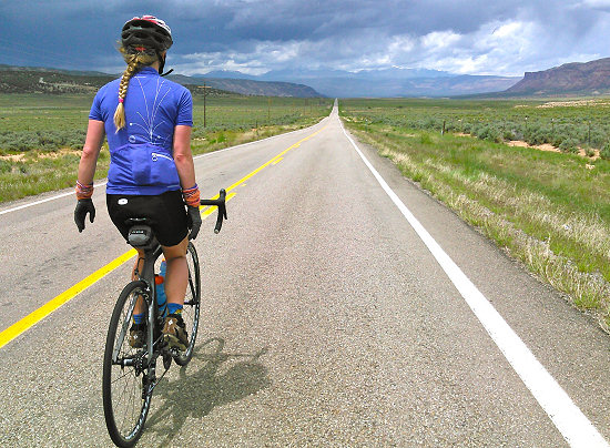 Riding through Paradox Valley with a storm on the horizon